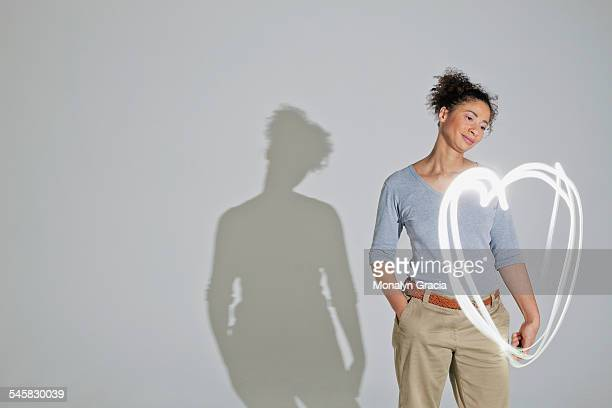 Woman looking at a heart