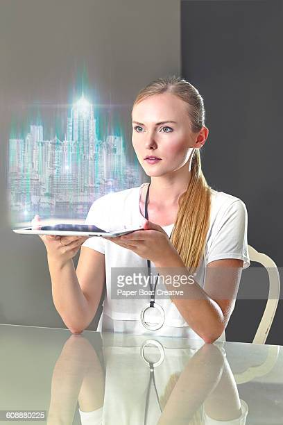 Woman looking at a hologram of a cityscape