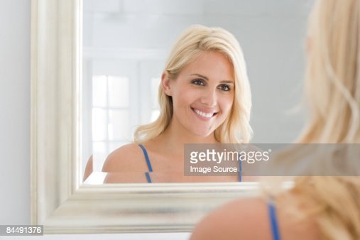 A woman looking at a mirror