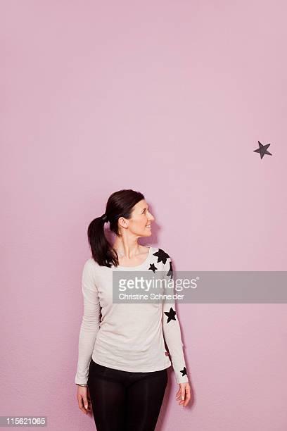 Woman looking at a star