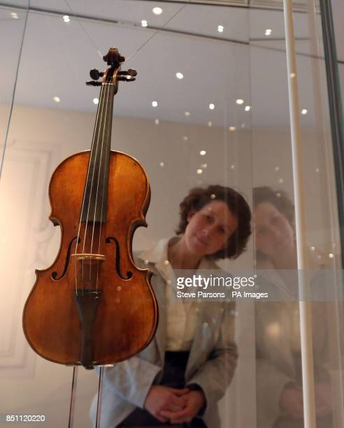 A woman looking at a Stradivarius violin at the new Stradivarius exhibition at the Ashmolean Museum in Oxford