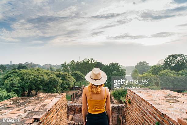 Woman looking at ancient Buddhist Temple