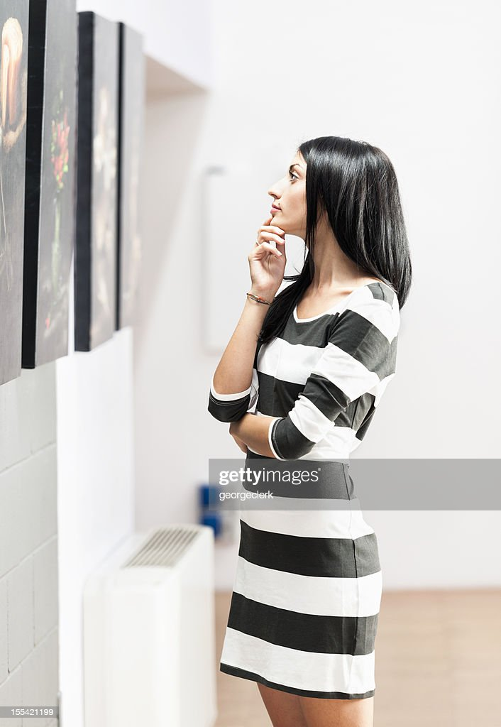 Woman Looking at Art Gallery Pictures : Stock Photo