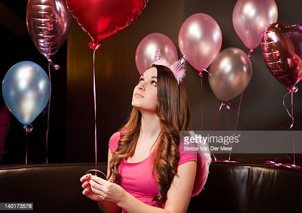 Woman looking at balloon.