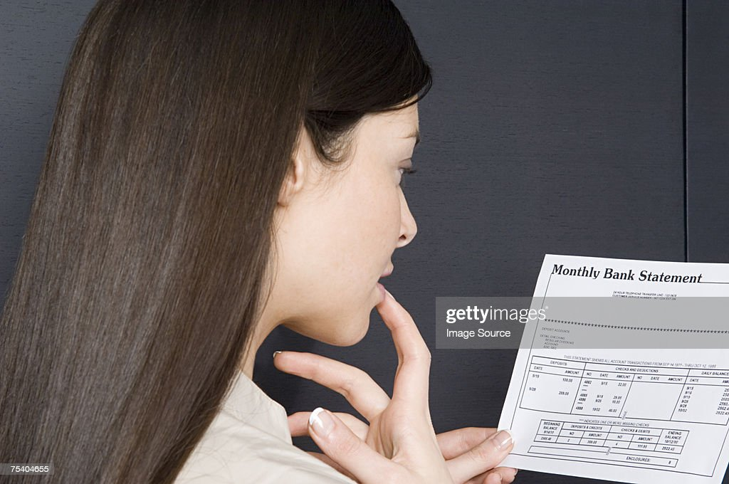 Woman looking at bank statement