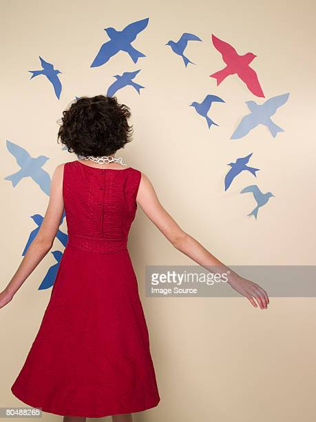 Woman looking at birds