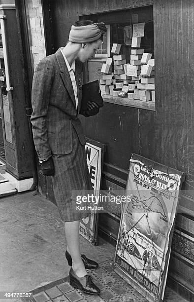 A woman looking at black market cosmetics displayed at a street kiosk UK World War II September 1941 Original Publication Picture Post 868 I Take A...