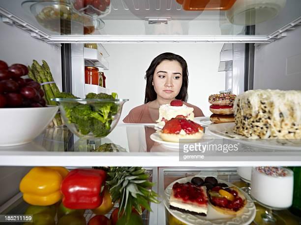 Woman Looking at Cake