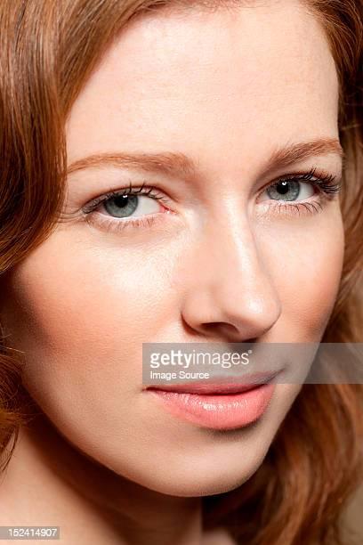 Woman looking at camera, close up