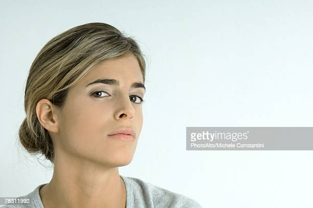 Woman looking at camera, portrait