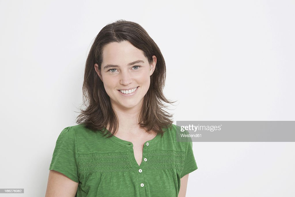 Portrait of mid adult woman on white background : Stock Photo