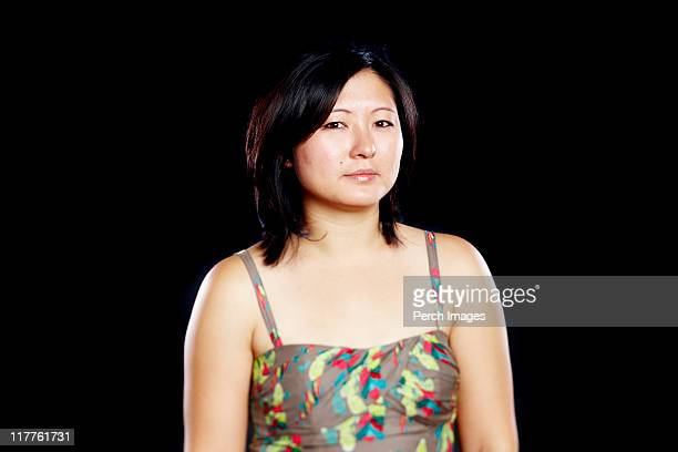 Woman looking at camera with serious expression