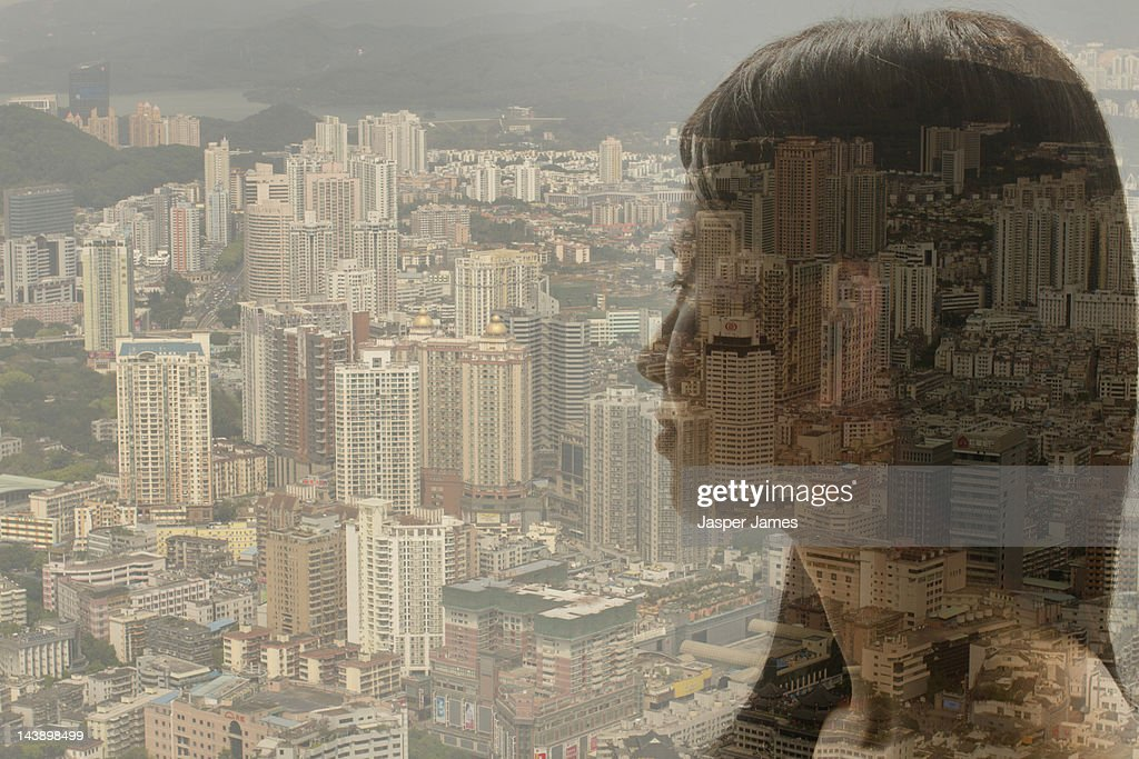 woman looking at cityscape : Stock Photo