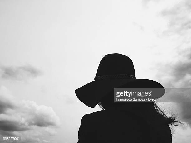 Woman Looking At Cloudy Sky