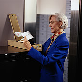 Woman Looking at Contents of a Safe Deposit Box