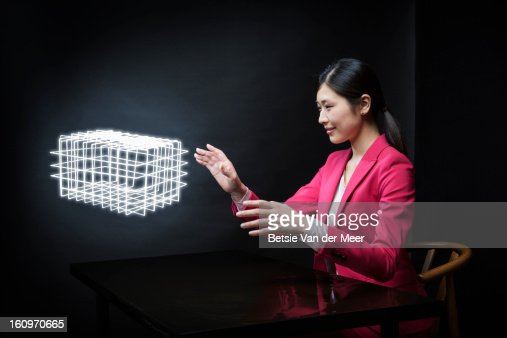 Woman looking at custommade virtual 3D model.. : Stock Photo