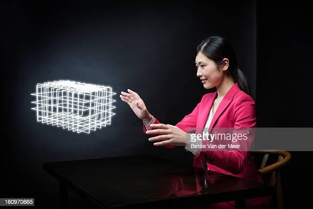 Woman looking at custommade virtual 3D model..