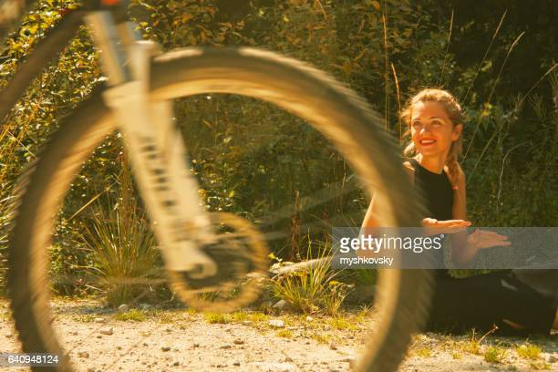 Woman looking at cyclist and smiles him