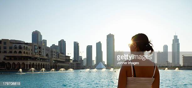 Woman looking at Dubai skyline