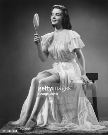 Woman Looking At Hand Mirror Stock Photo Getty Images