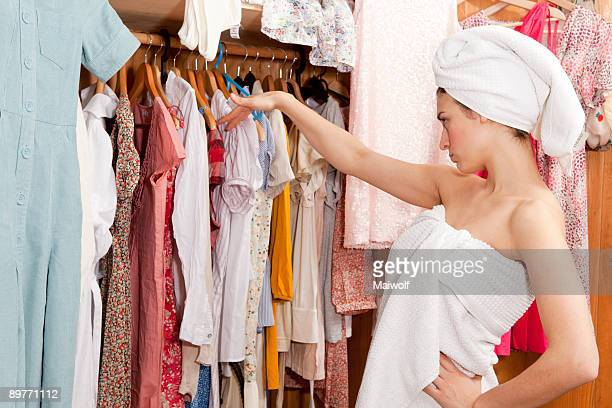 Woman looking at her clothes