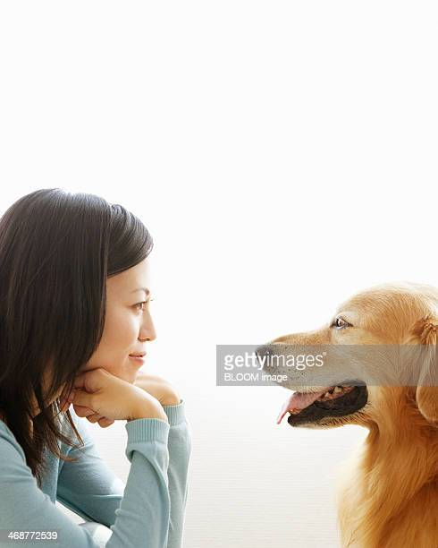 Woman Looking At Her Dog