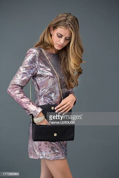Woman looking at her purse