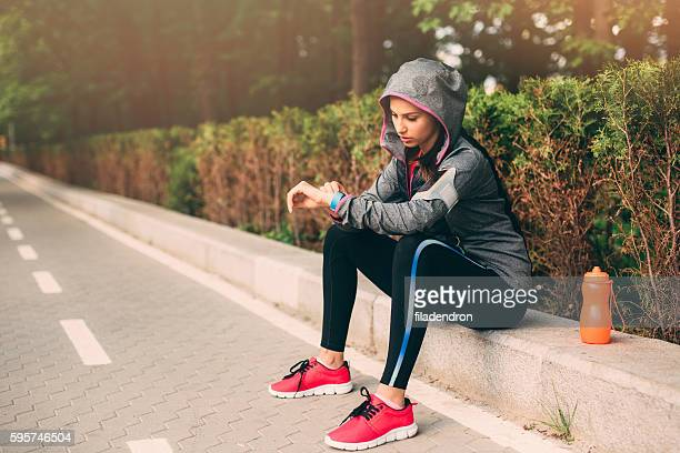 Woman looking at her sport watch