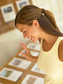 Woman looking at homes for sale
