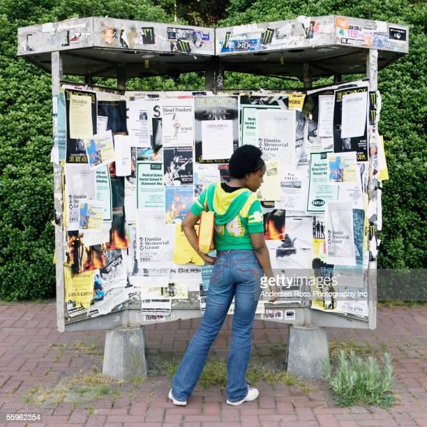 Woman looking at kiosk