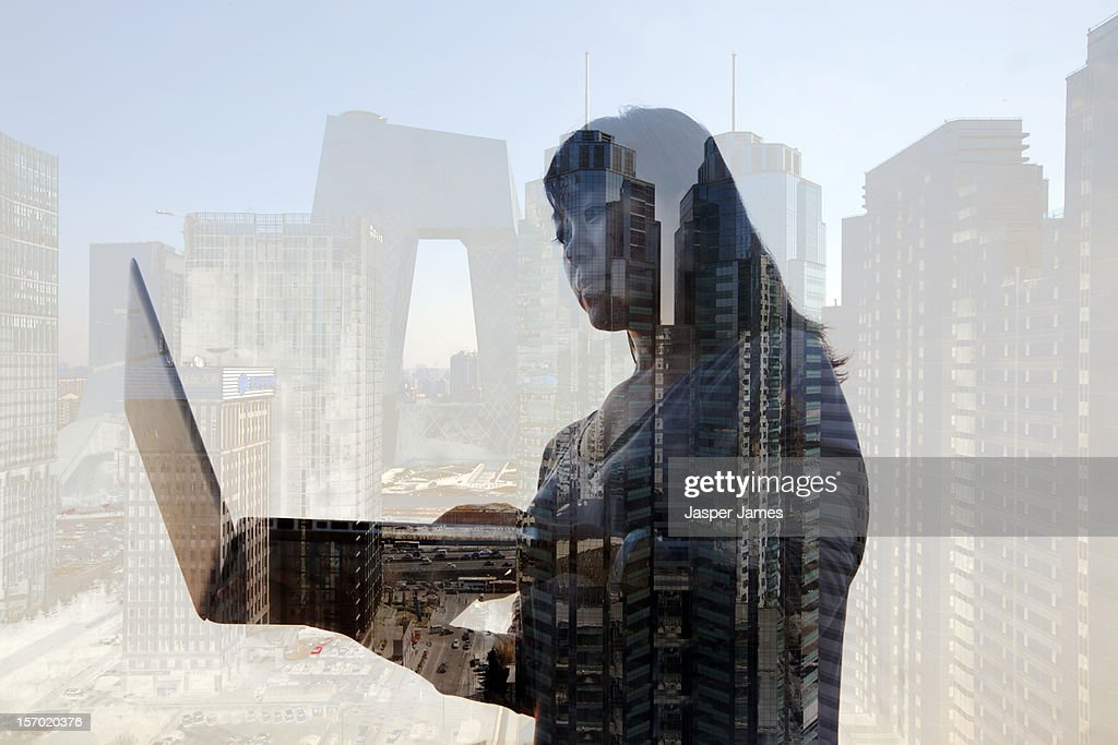 woman looking at laptop and Beijing in background : Stock Photo