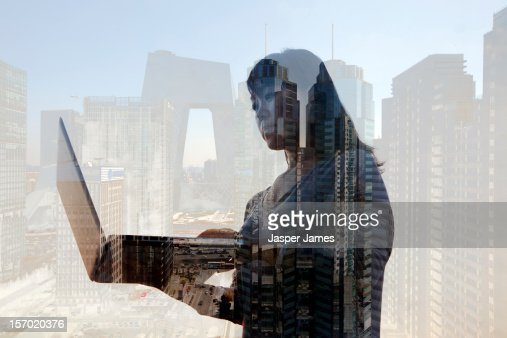 woman looking at laptop and Beijing in background : ストックフォト