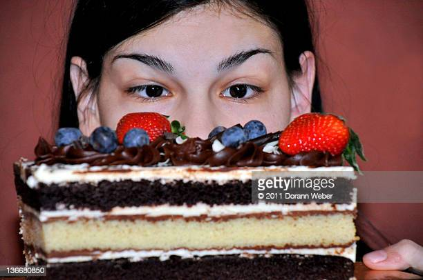 Woman looking at large Piece of Cake