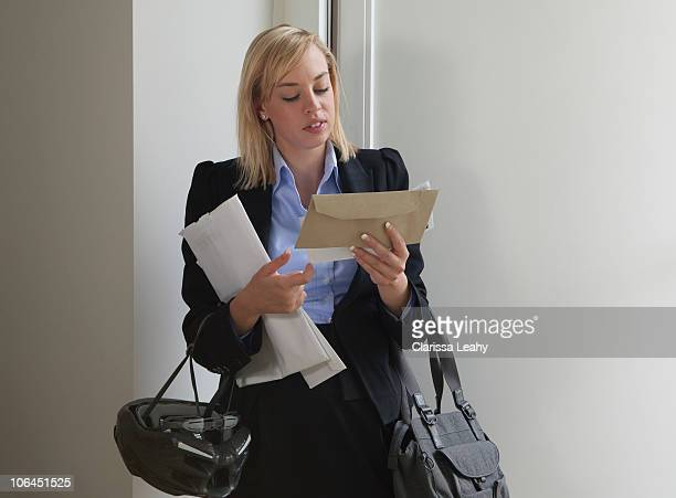 Woman looking at letters