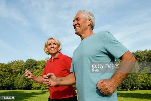 woman looking at man while running through park