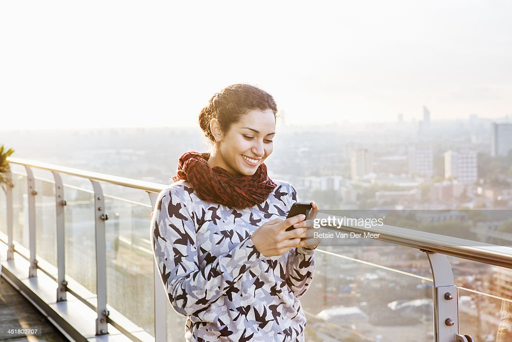 woman looking at mobile phone, elevated view. : Stock Photo