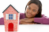 Woman Looking At Model House