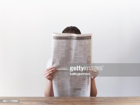 Woman looking at newspaper