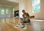 Woman looking at paint samples in empty room