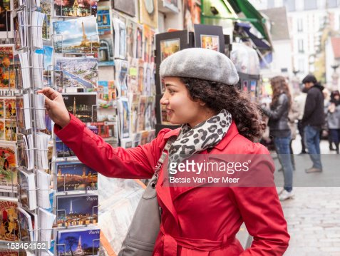 Woman looking at postcards at Montmartre, Paris. : Stock Photo