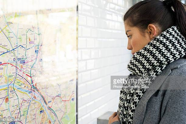 Woman looking at public transit map