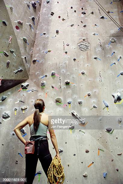 Woman looking at rock climbing wall
