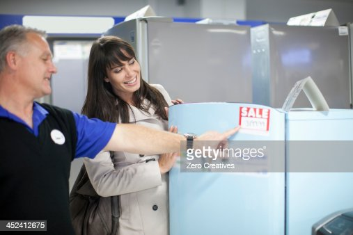Woman looking at sale appliances in showroom
