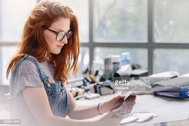 Woman looking at samples