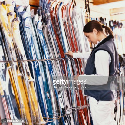 Woman Looking at Skis in Store