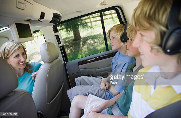 Woman Looking at Sons in Back Seat