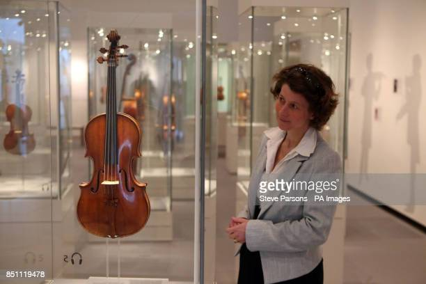 A woman looking at Stradivarius violins at the new Stradivarius exhibition at the Ashmolean Museum in Oxford