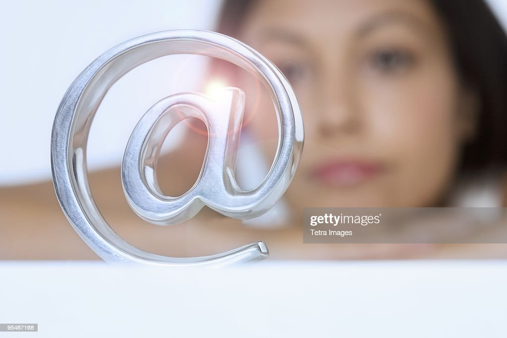 Woman looking at @ symbol