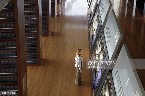 A woman looking at the 120foot timeline exhibit in the William J Clinton Presidential Library