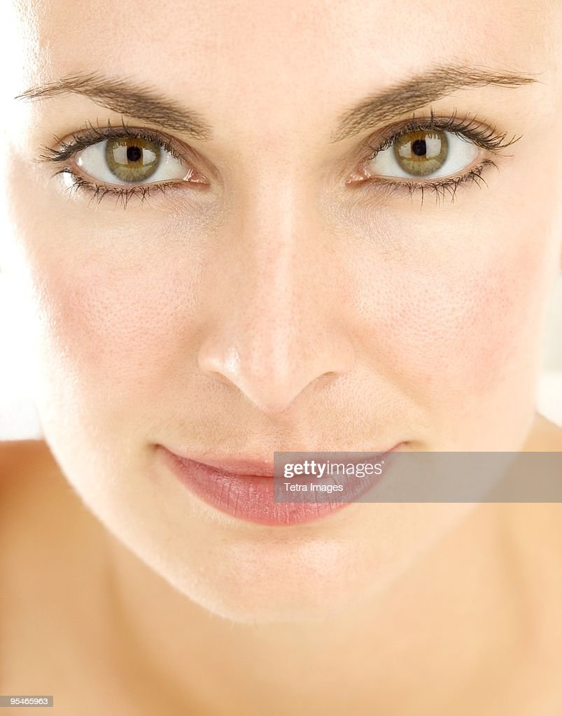 A woman looking at the camera : Stock Photo